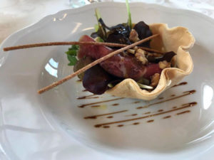 involtino di coppa di testa, salume tipico locale, con fagiolini in vinaigrette e noci